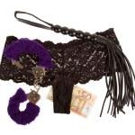 Постер, плакат: Fluffy purple handcuffs a whip money and panties prostitution