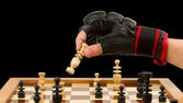 Playing chess in freefight gloves, isolated — Stock Photo