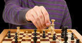 Chessboard with man thinking about chess strategy, isolated — Stock Photo