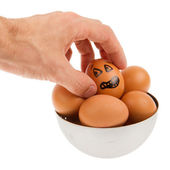 Scared egg, waiting to be grabbed by a hand — Stock Photo