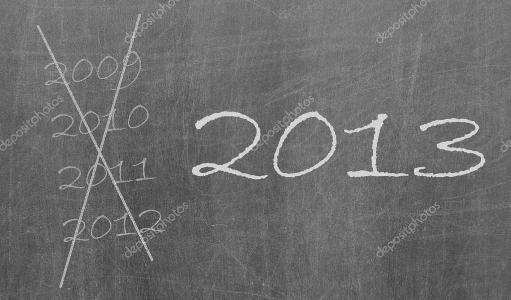 2009, 2010 and 2012 crossed and new year 2013 written on chalkboard, isolated  Stock Photo #14800343