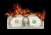 Burning dollar bill symbolizing careless money management — Stock Photo