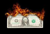 Burning dollar bill symbolizing careless money management — Stock Photo