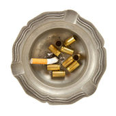 Empty 9mm bullet casings in an old tin ashtray — Stock Photo