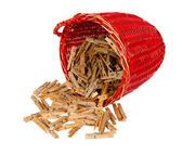 Very old red basket with wooden clothespins — Stock Photo