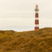 Red and white lighthouse — Stock Photo