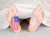 USA flag tag on the foot — Stock Photo