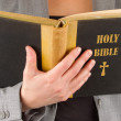 Royalty-Free Stock Photo: Woman in business suit is reading a holy bible