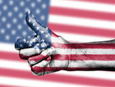 US flag on thumbs up hand — Stock Photo