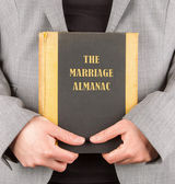 Woman holding a marriage almanac — Stock Photo