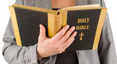 Woman in business suit is reading a holy bible — Stock Photo