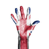 Hand of an old woman, wrapped with a pattern of the flag of the — Stock Photo