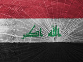 Broken glass or ice with a flag, Iraq — Stock Photo