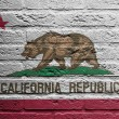 Brick wall with a painting of a flag, California — Stock Photo