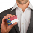 Stock Photo: Businessmis holding business card, North Carolina