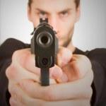 Man with a gun ready to shoot — Stock Photo