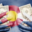 Sweaty girl covered her breast with money, flag of Colorado — Stock Photo