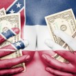 Sweaty girl covered her breast with money, flag of Mississippi — Stock Photo