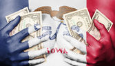 Sweaty girl covered her breast with money, flag of Iowa — Stock Photo