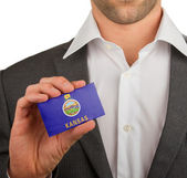 Businessman is holding a business card, Kansas — Stock Photo