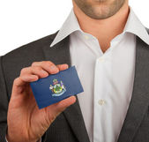 Businessman is holding a business card, Maine — Stock Photo