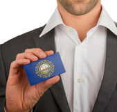 Businessman is holding a business card, New Hampshire — Stock Photo