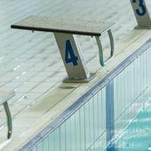 Swim race starting block — Stock Photo