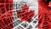 Broken ice or glass with a flag pattern, Canada — Stock Photo