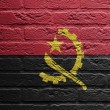 Brick wall with a painting of a flag,  Angola — Lizenzfreies Foto