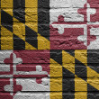 Brick wall with a painting of a flag, Maryland — Stock Photo