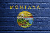 Brick wall with a painting of a flag, Montana — Stock Photo
