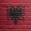 Brick wall with a painting of a flag, Albania - Lizenzfreies Foto