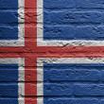pared de ladrillo con una pintura de una bandera, Islandia — Foto de Stock