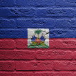 Photo: Brick wall with painting of flag, Haiti