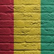 Brick wall with a painting of a flag, Guinea - Stockfoto