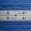 Brick wall with a painting of a flag, Honduras - Lizenzfreies Foto