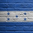 Brick wall with a painting of a flag, Honduras - Stockfoto