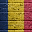 Brick wall with a painting of a flag, Romania — Stockfoto