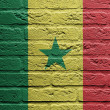 Brick wall with a painting of a flag, Senegal - Stockfoto