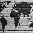 Brick wall with a painting of a flag, World Map — Stock Photo