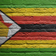 Royalty-Free Stock Photo: Brick wall with a painting of a flag,  Zimbabwe