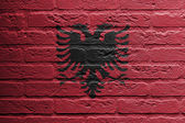 Brick wall with a painting of a flag, Albania — Stock Photo