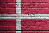 Brick wall with a painting of a flag, Denmark — Stock Photo