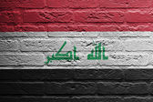 Brick wall with a painting of a flag, Iraq — Stock Photo