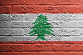 Brick wall with a painting of a flag, Lebanon — Stock Photo