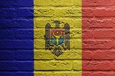 Parede de tijolo com uma pintura de uma bandeira, moldávia — Fotografia Stock