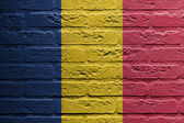 Brick wall with a painting of a flag, Romania — Stok fotoğraf