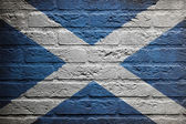 Brick wall with a painting of a flag, Scotland — Stock Photo