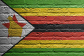 Brick wall with a painting of a flag, Zimbabwe — Stock Photo
