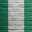 Stock Photo: Brick wall with painting of flag, Nigeria